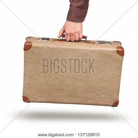 Male hand holding old vintage suitcase isolated on white