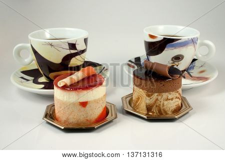Chocolate And Fruit Pastry On White Background With Cup Of Coffee