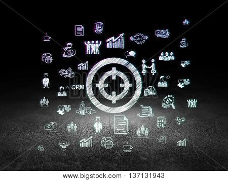 Finance concept: Glowing Target icon in grunge dark room with Dirty Floor, black background with  Hand Drawn Business Icons