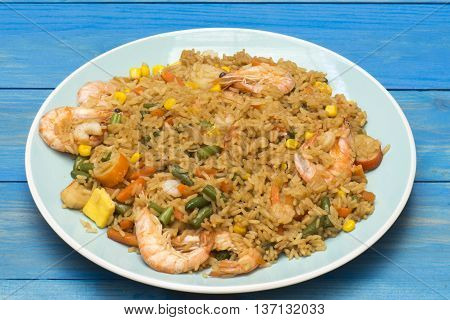 Rice with seafood, fried king prawns with  rice and vegetables