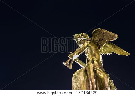 Angel statue isolated playing musical instrument -