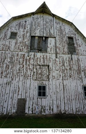 A closeup view of the side of an abandoned 19th century barn which stands in the Plainfield Park District's Eaton Preserve in Plainfield, Illinois.