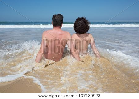 Way Of Life Of Couple At The Beach, Nudism