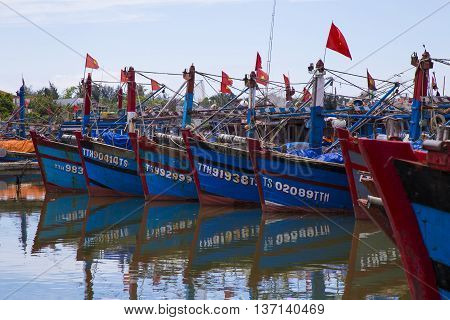 Hue, Vietnam - Jun 20, 2016: Vietnamese wooden fishing boat anchoring at a harbor to avoid hurricane storm on a shore in Thuan An beach, central Vietnam.