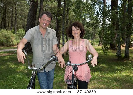 Cheerful Happy Couple Outdoor Having Good Time Vith Bicycle