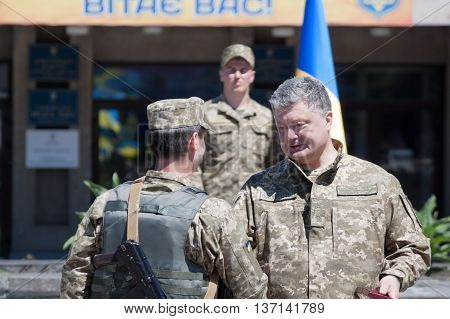 SLOVIANSK UKRAINE - JULY 5 2016: President of Ukraine Petro Poroshenko has awarded the soldier of the Armed Forces of Ukraine in Sloviansk at the ceremonial meeting in honor of the second anniversary of Sloviansk liberation from Russian fighters