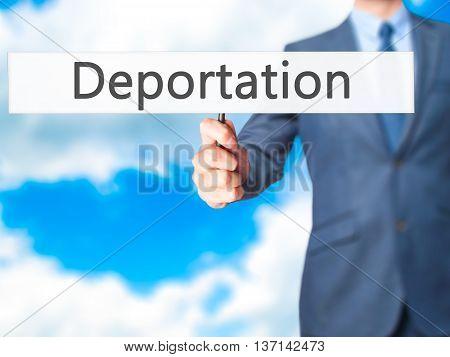 Deportation - Businessman Hand Holding Sign