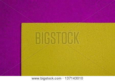 Eva foam ethylene vinyl acetate lemon yellow surface on pink sponge plush background