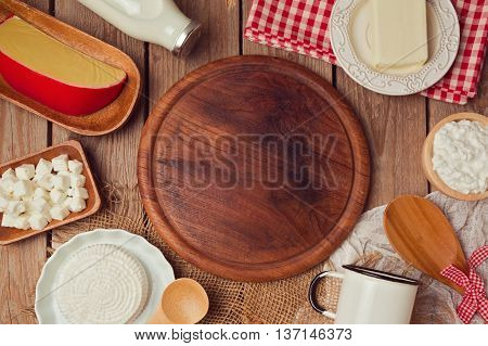 Wooden board with milk and cheese. Place for text. Healthy eating concept. View from abobe. Flat lay