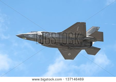 FARNBOROUGH, UK - JULY 5: Low level flight by a Lockheed Martin F-35B Lightning II in the skies over Farnborough, Hampshire, UK on July 5, 2016