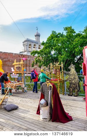 VELIKY NOVGOROD RUSSIA -JUNE 11 2016. Belfry of St Sophia cathedral with tourist attraction objects and souvenir trade in Veliky Novgorod Russia