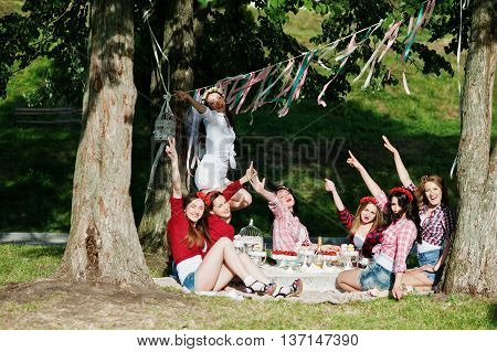 Happy And Sexy Girls Sitting At Picnic Table And Having Fun On Bachelorette Party