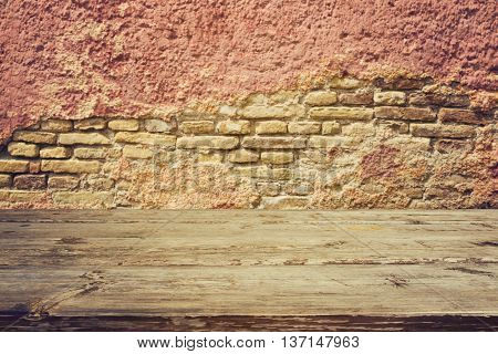 Empty vintage wooden table over old brick wall background