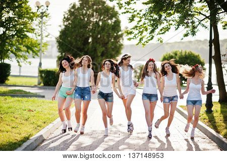 Seven Happy And Sexy Girls On Short Shorts And White Shirts Running Fun On Road At Park On Bachelore