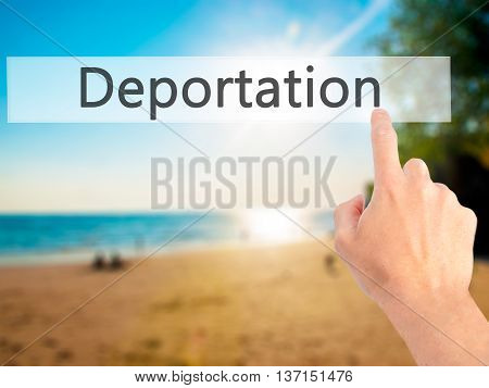 Deportation - Hand Pressing A Button On Blurred Background Concept On Visual Screen.