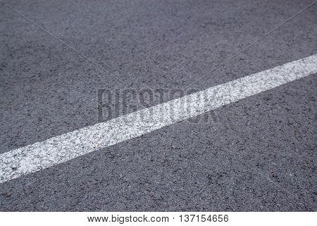 asphalt detail texture background with white line