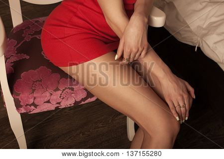 sexy woman long leg in red dress in hotel room.