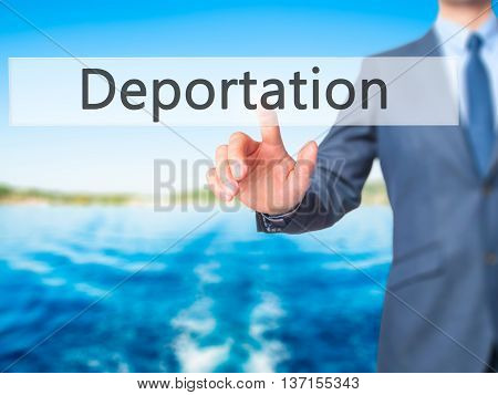 Deportation - Businessman Hand Pushing Button On Touch Screen