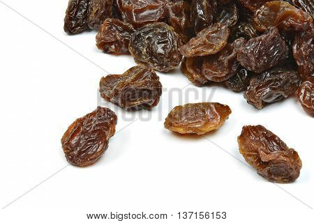 black raisins on a white background (dried fruits)