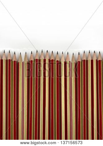 Close up of pencils lines up on white background