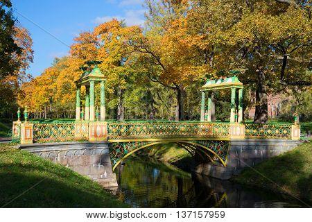 SAINT PETERSBURG, RUSSIA - OCTOBER 02, 2014: Chinese bridge, golden autumn. October in the Alexander park of Tsarskoye Selo, Russia. Historical landmark of Saint Petersburg