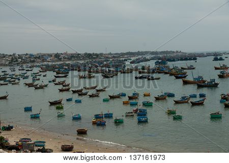 Fishing village, market and traditional fishing boats, one of the best places in Mui Ne, Vietnam.
