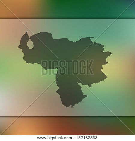 Venezuela map on blurred background. Blurred background with silhouette of Venezuela.