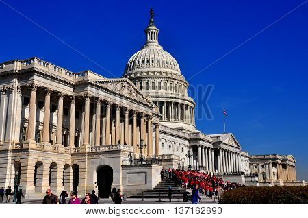 Washington DC - April 10 2014: The east front of the United States Capitol with the House of Representatives wing on the right the Senate at far left and the great dome *