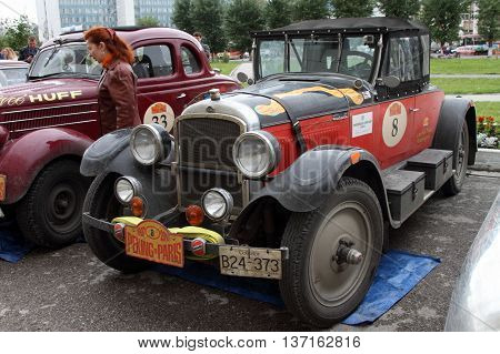 PERM RUSSIA - JUNE 29: Rally of retro-cars Peking-Paris 2016 June 29 2016 in Perm Russia. Cars are in the city after the next stage.