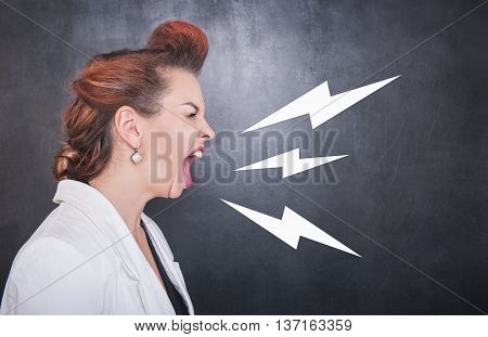Angry Screaming Woman On Blackboard Background