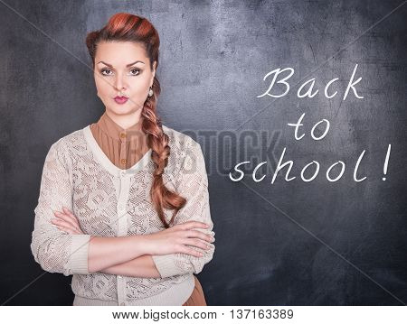 Strict Teacher On Blackboard Background