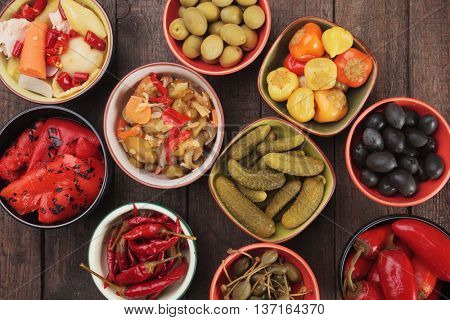 Pickled cucumber, peppers, chili, olives and caper fruit