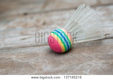 A colorful shuttlecock, used to play a game of badminton.