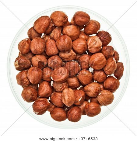 Unshelled Hazel Nuts In A Glass Bowl