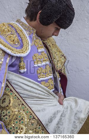 Linares SPAIN - August 28 2014: Spainish bullfighter Sebastian Castella putting itself the walk cape in the alley before going out to bullfight typical and very ancient tradition in Linares Jaen province Spain