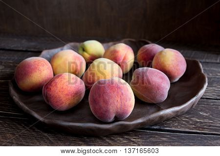 peaches on a brown background ripe peaches fragrant peaches