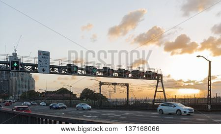 Sydney - February 27 2016: Entrance to the large Harbour Bridge at sunset and cars with headlights on go over the bridge Feb. 27 2016 Sydney Australia