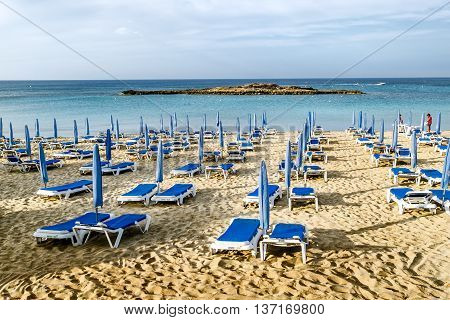 May 24 2016.Protaras.Chairs with umbrellas on the beach in Fig tree Bay in Protaras .Cyprus.