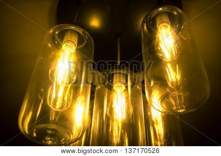 Decorative antique style hanging light bulbs chandelier background