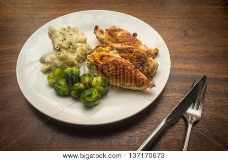 Fried chicken breast meal with brussel sprouts and mashed potatoes