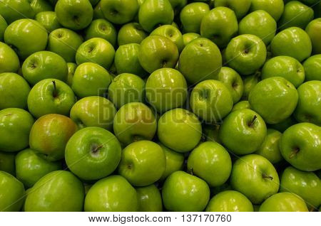Ripe organic green apples on display at local farmers market