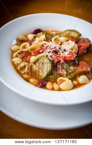 Bowl of hearty Italian minestrone soup with bread sticks