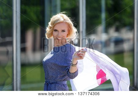 Beautiful Smiling Blond Model Posing With Fluttering Kerchief