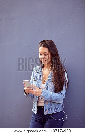 Pretty Young Girl Typing A Message On Cell Phone