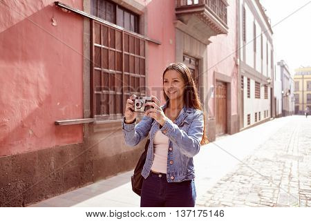 Pretty Young Girl Aiming To Take A Picture