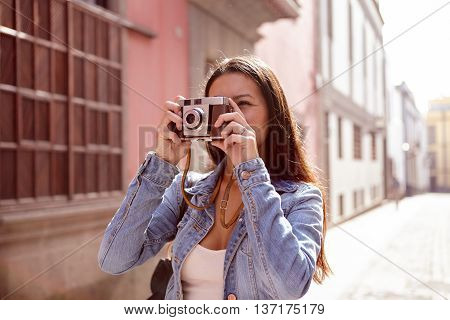 Cute Young Girl Taking A Picture On Her Camera