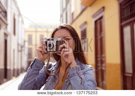 Young Girl Taking A Picture In A Narrow Street