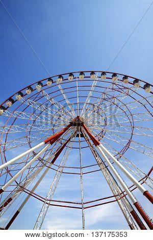 Ferris Wheel And Blue Sky In Sun Day
