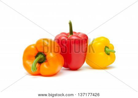 Bulgarian peppers of different colors on a white background. horizontal photo.