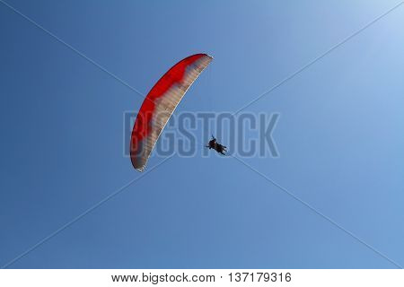 Paragliding in the sky tandem of instructor and beginner